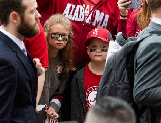 Young fans watch as Alabama arrives before the Alabama vs. Western Carolina game on the UA campus in Tuscaloosa, Ala., on Saturday, November 23, 2019.