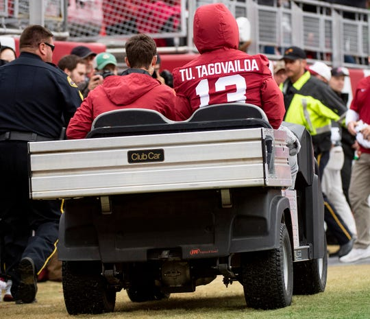 Alabama's injured  quarterback Tua Tagovailoa (13) is carted around the field during the Western Carolina game at Bryant-Denny Stadium in Tuscaloosa, Ala., on Saturday, November 23, 2019.