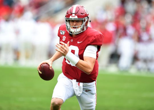Nov 23, 2019; Tuscaloosa, AL, USA; Alabama Crimson Tide quarterback Mac Jones (10) scrambles up the field against the Western Carolina Catamounts during the second quarter at Bryant-Denny Stadium. Mandatory Credit: John David Mercer-USA TODAY Sports