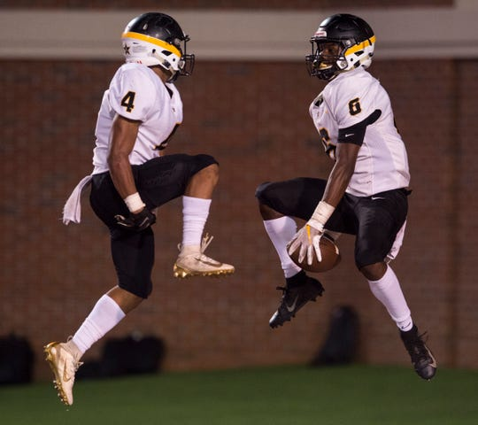 Autauga's Teddy Harris (4) and Autauga's Raymond Cutler (6) celebrate Cutler's touchdown catch, the play was called back on a penalty, during the AISA Class AA State Championship at Veterans Memorial Stadium in Troy, Ala., on Friday, Nov. 22, 2019. Autauga defeated Escambia 23-6.