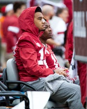 Injured players Alabama quarterback Tua Tagovailoa (13) and wide receiver Henry Ruggs, III, (11) watch the game against Western Carolina from a cart in the team area at Bryant-Denny Stadium in Tuscaloosa, Ala., on Saturday, November 23, 2019.