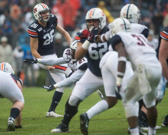 Auburn kicker Anders Carlson (26) has his field goal blocked by Samford defenive back Joshua Carter (21) at Jordan-Hare Stadium in Auburn, Ala., on Saturday, Nov. 23, 2019. Auburn leads Samford 31-0 at halftime.