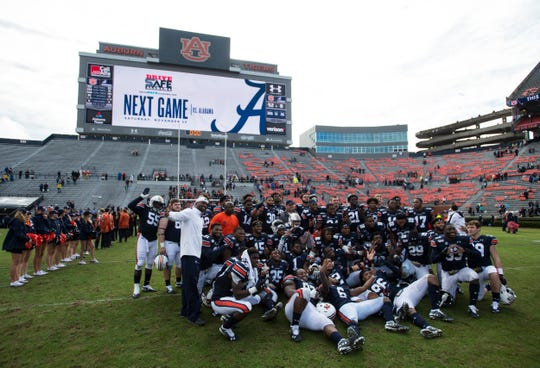 Auburn defensive players pose for a picture after the game at Jordan-Hare Stadium in Auburn, Ala., on Saturday, Nov. 23, 2019. Auburn defeated Samford 52-0.