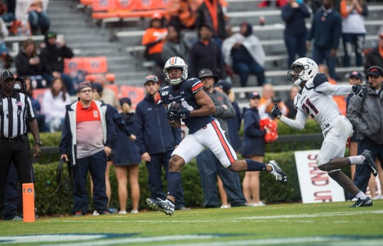 Auburn wide receiver Zach Farrar (14) catches a pass for a touchdown  at Jordan-Hare Stadium in Auburn, Ala., on Saturday, Nov. 23, 2019. Auburn defeated Samford 52-0.