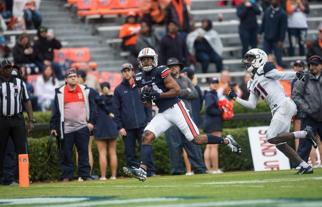 Auburn wide receiver Zach Farrar (14) catches a pass for a touchdown  at Jordan-Hare Stadium in Auburn, Ala., on Saturday, Nov. 23, 2019. Auburn defeated Samford 52-0.