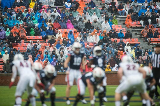 Fans enjoy the game despite the rain during warm ups at Jordan-Hare Stadium in Auburn, Ala., on Saturday, Nov. 23, 2019. Auburn leads Samford 31-0 at halftime.