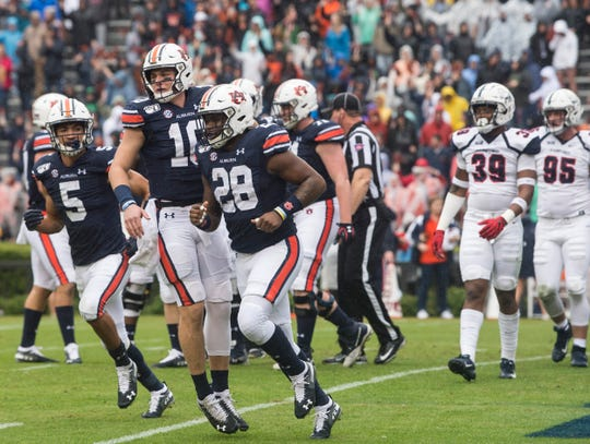 Auburn quarterback Bo Nix (10),  running back JaTarvious Whitlow (28) and wide receiver Anthony Schwartz (5) celebrate a touchdown against Samford on Saturday, Nov. 23, 2019.