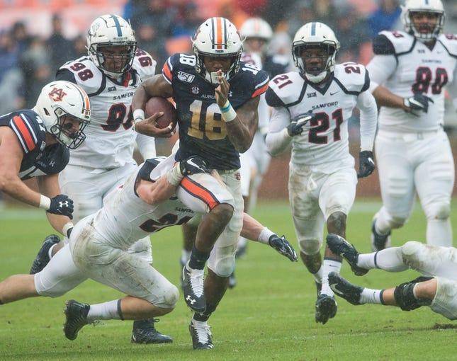 Auburn wide receiver Seth Williams (18) runs the ball after a catch at Jordan-Hare Stadium in Auburn, Ala., on Saturday, Nov. 23, 2019. Auburn leads Samford 31-0 at halftime.