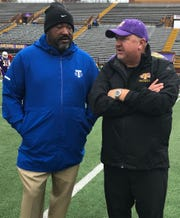 Tennessee State coach Rod Reed, left, chats with Tennessee Tech coach Dewayne Alexander at Tucker Stadium.