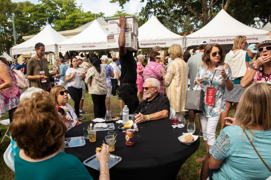People enjoy food and wine during the 2019 Paradise Coast Food and Wine Experience on Saturday, Nov. 23, 2019, at Cambier Park in Naples.