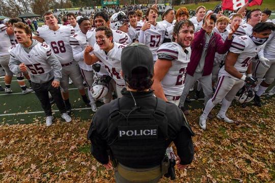St. Joseph hosts Don Bosco in a Non-Public Group 4 football semifinal on Saturday, November 23, 2019. DB reacts to their fans in the bleachers as they celebrate defeating SJ.