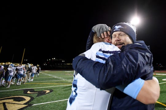 Northern Valley at Old Tappan hosts Wayne Valley in a North 2, Group 4 football sectional final on Friday, November 22, 2019. WV Head Coach Roger Kotlarz celebrates with #5 Jake DeLuccia after defeating OT.