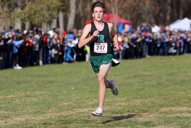 Jackson Barna, of Ridge, gets ready to cross the finish line in seventh place with a time of 15:55. Saturday, November 23, 2019