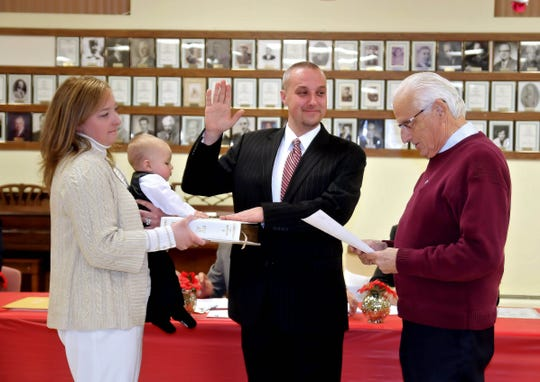 Councilman Brunacki IV being sworn in to his first term in 2014 by Rep. Bill Pascrell Jr.