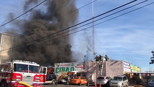 A fire started in a garage in Paterson on Nov. 23, 2019.