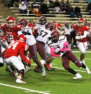Joey Reza (2) pounds the ball inside for tough yards against Roswell.