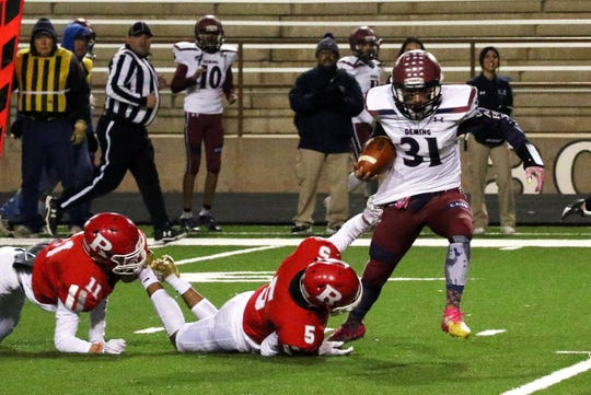 Senior quarterback Jesse Varela (31) capped his Wildcat football career Friday night with an 85-yard touchdown run late in the fourth quarter against top-rated Roswell High.