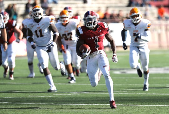 NMSU senior running back Jason Huntley (1) runs for a touchdown as UTEP faced off with New Mexico State in their annual rivalry game at Aggie Memorial Stadium on Saturday, Nov. 23, 2019 in Las Cruces, N.M.