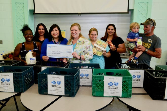 A $25,000 grant from Blue Cross and Blue Shield of New Mexico is helping feed homeless children on the weekend at Jardin de los Niños.