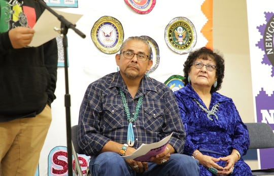 At left, Navajo Language Teacher Lawrence Yazzie and Principal Ethel Manuelito watch a student read his poem during the Falcon Poetry Slam on Nov. 22 at Newcomb Middle School in Newcomb.