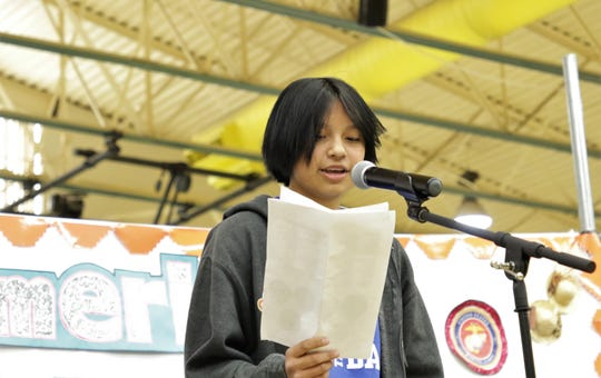 Shayna Nakai reads her poem during the Falcon Poetry Slam at Newcomb Middle School on Nov. 22 in Newcomb.