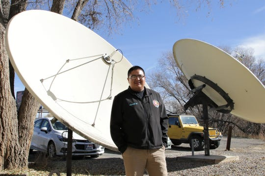 Program director and morning show host Lydell Rafael next to KNDN's radio transmitters in Farmington on Nov. 18, 2019.
