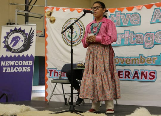 Niayla Curley reads her poem during the Falcon Poetry Slam at Newcomb Middle School on Nov. 22 in Newcomb.