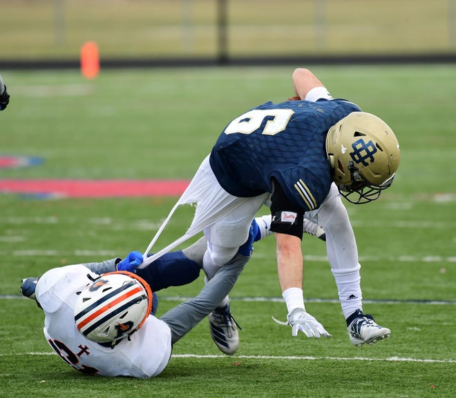 Country Day's Anthony Ammori breaks a tackle against Flint Powers Catholic.