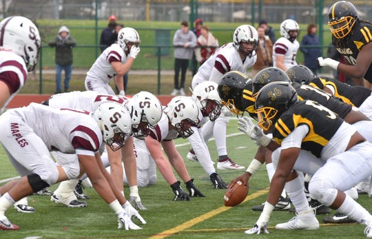 The Birmingham Seaholm defense, left,  lines up against Detroit King.