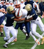 Country Day's Taj Abdur-Rahman and Saborn Campbell make a tackle against Flint Powers Catholic.