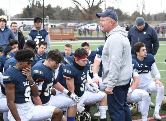 Country Day coach Dan McLean speaks to the team after beating Flint Powers Catholic on Nov. 23, 2019.