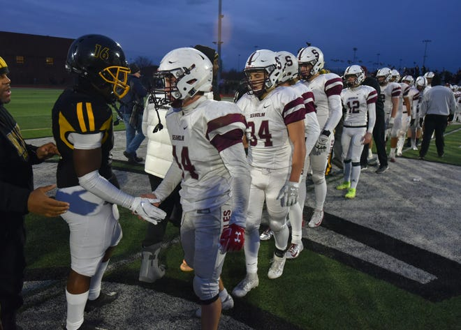 Birmingham Seaholm lines up to congratulate Detroit King on a good game after the Maples bowed out of the football playoffs at Novi High on Nov. 23, 2019.