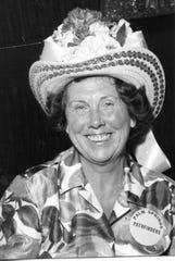 Hildy Crawford, society reporter for the Desert Sun, in a resplendent hat.