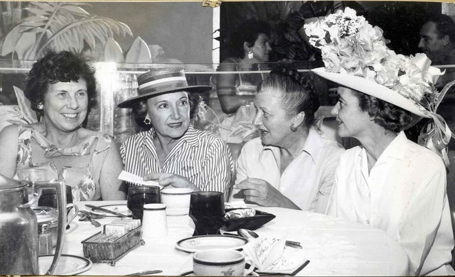 Planning the Hat Parade at the Chi Chi are, left to right, Hildy Crawford, Anita Haskell Jones, Mary Noel and Jane Wade.
