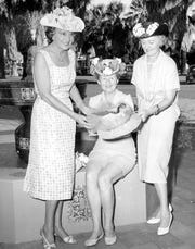 Hat Time in the Old Town of Palm Springs: Melba Bennett (seated) with friends showing off their creations.