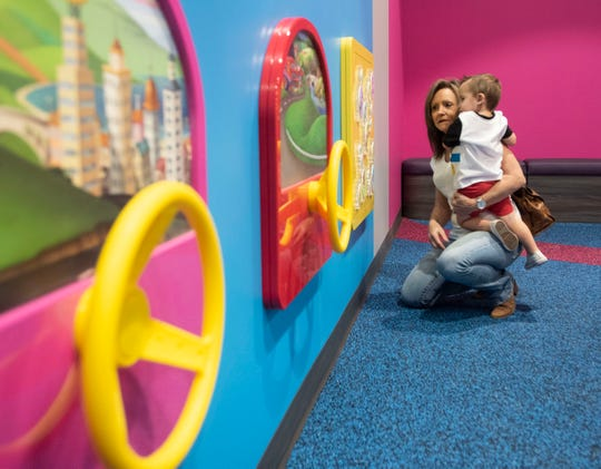 Cheryl Hoord and her grandson, Brody Toole, explore the Discovery Junior Play Zone at Cordova Mall on Friday, Nov. 22, 2019. The new 3,000 square-foot Disney themed activity zone caters to kids ten-years-old or less.