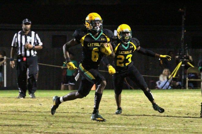Pensacola Catholic's Damarius McGhee (6) returns a punt for a touchdown against Florida High on Nov. 22, 2019.