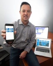 Tal Clark shows off his company's Coflyt app, designed to help the aviation industry streamline many of its processes.