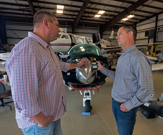 Tal Clark shows off his company's new CoFlyt app to Gregory Sigler, the vice president of Skywarrior, on Friday, Nov. 22, 2019. The software app allows pilots and aircraft owners to keep track of maintenance, flight time, and other ownership related records in one thier electronic devices.