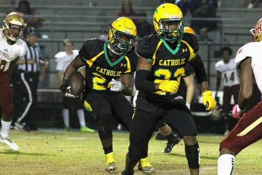 Pensacola Catholic running back Waymond Jordan (24) rushes against Florida High on Nov. 22, 2019.