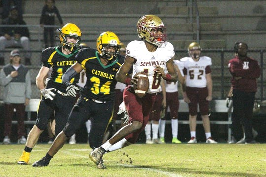 Florida High's Willie Taggart Jr. (10) throws a game-winning Hail Mary against Pensacola Catholic on Nov. 22, 2019.