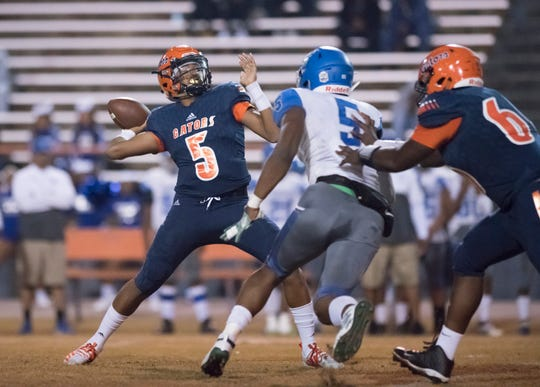 Quarterback AV Smith (5) passes during the Lee vs Escambia playoff football game at Escambia High School in Pensacola on Friday, Nov. 22, 2019.