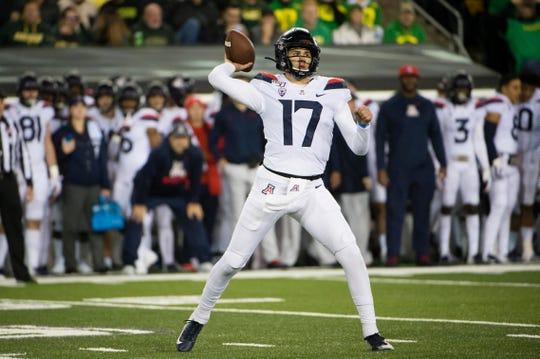 Arizona Wildcats quarterback Grant Gunnell (17) throws a pass during the first half against the Oregon Ducks at Autzen Stadium.