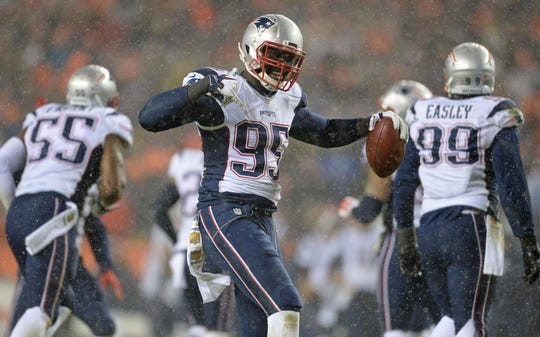 Patriots defensive end Chandler Jones (95) celebrates after intercepting a pass during a game against the Broncos on Nov. 29, 2015 at Sports Authority Field at Mile High.