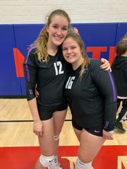 Northwest Christian girls volleyball players Zoe Dalessandri (left) and Emma Harmeyer