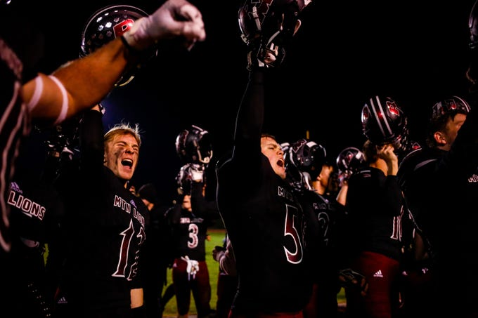 Red Mountain Mountain Lions celebrate after Red Mountain Mountain Lions wins the Red Mountain High School vs. Queen Creek High School 6A semifinals game Friday, November 22, 2019 at Westbrook High School in Mesa. (Nicole Neri/The Republic)
