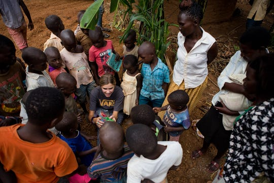Claire Pothier talks to a group of children and mothers in Uganda