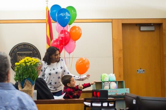 Khadijah Lewis and Ezrah Lewis choose a toy after being officially adopted by Kim Lewis during Maricopa County's National Adoption Day Celebration, where over 140 children formerly in foster care had their adoptions finalized Saturday, Nov. 23, 2019, at Durango Juvenile Court Center in Phoenix.