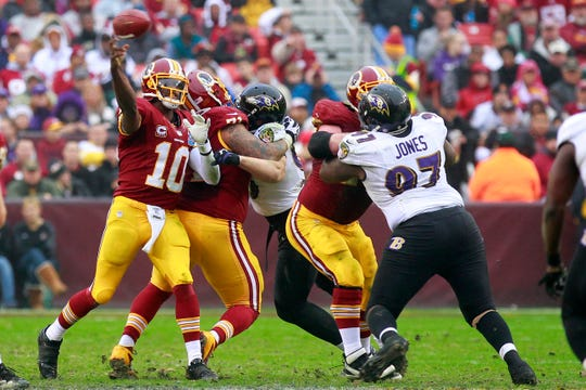 Ravens defensive end Arthur Jones III pressures Redskins quarterback Robert Griffin III during a game Dec. 9, 2012.