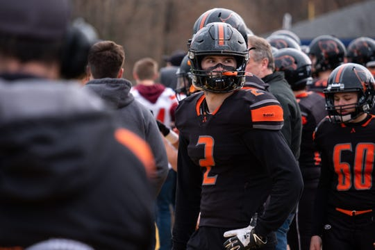 Almont running back Michael Lulgjuraj watches the MHSAA Division 5 state semifinals against Detroit Denby from the sidelines Saturday, Nov. 23, 2019, at Walled Lake Central.